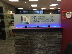 custom indoor lighted lobby sign